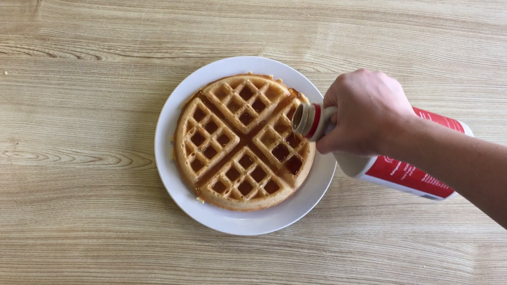 How to serve a waffle with maple syrup.